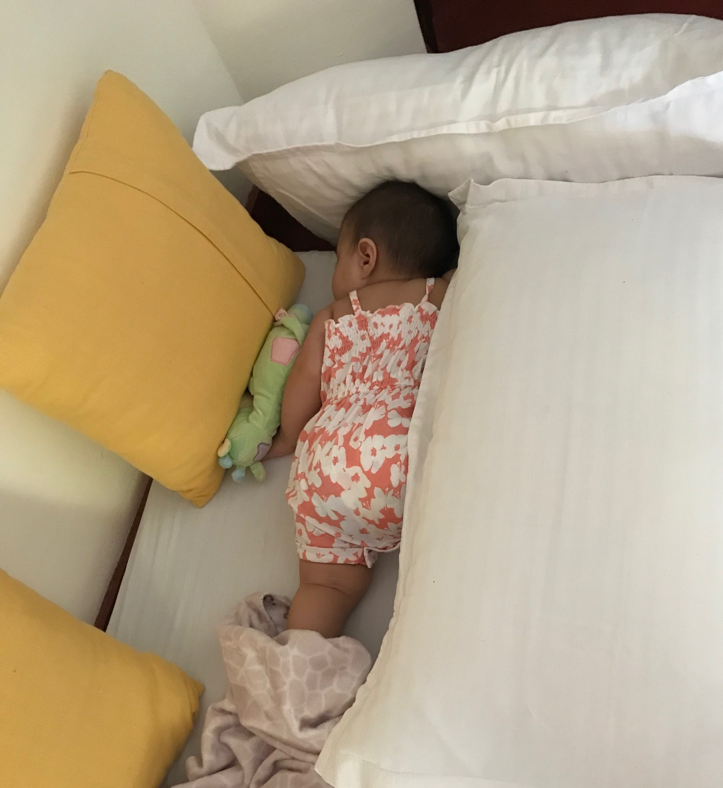 With no crib available at a home stay in Kerala, a floor mattress and pillows kept my daughter comfortable