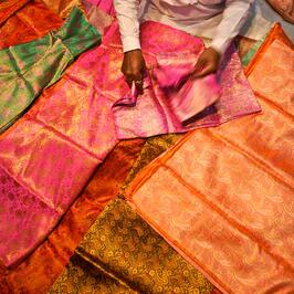 Legends of India, a small group tour. Fabrics in Chandni Chowk market, Delhi.