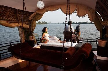 Legends of India, a small group tour. Experience a traditional houseboat in Kerala.