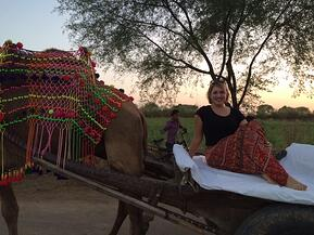 One of Sodha Travel's guests, Molly, on the camel safari
