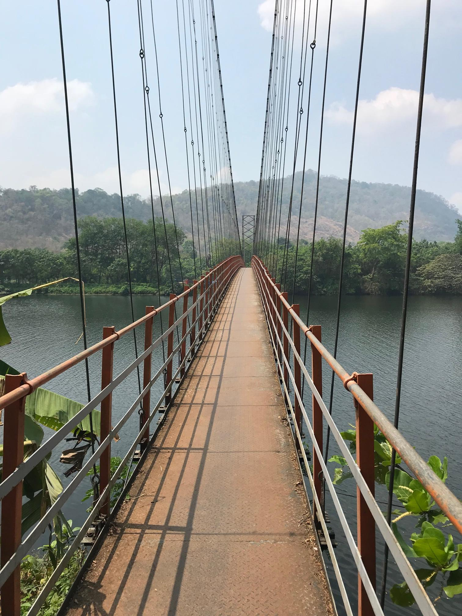 Walk or cycle to the nearby suspension bridge over the Periyar River