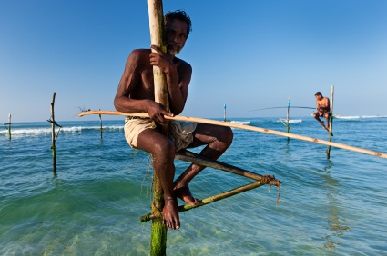 Stilt fishermen in Sri Lanka during the best weather.
